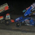 Jonathan Cornell (28) and Tim Crawley battle for position during ASCS Warrior sprint car action at Double XX Speedway in Missouri. (Ken Simon photo)