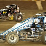 Hunter Schuerenberg, Brent Beauchamp and Tracy Hines go three wide during action in the B Main Monday at Kokomo (Ind.) Speedway. (Carey Akin Photo)