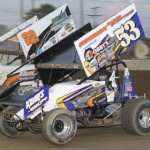 Phil Gressman (53) battles Ryan Broughton during 410 winged sprint car competition at Ohio's Fremont Speedway. (Action photo)