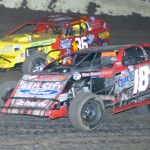 Michael Long (18L) fights off Conrad Miner during UMP modified competition at Federated Auto Parts Raceway in Pevely, Mo. (Don Figler photo)
