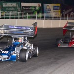 Jeff Locke (37) chases eventual winner Dave Gruel during the ISMA supermodified portion of the King of Wings promotion at New York's Oswego Speedway. (Jim Feeney photo)