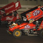 Donny Schatz (15) battles Joey Saldana during the 49th Knoxville Nationals in 2009 at Knoxville (Iowa) Raceway. (Mark Funderburk Photo)