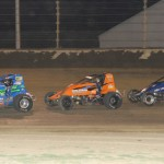 Eventual winner Dave Darland (11) leads Chris Windom and Levi Jones during Sunday night's sprint car feature at Kokomo (Ind.) Speedway. (Gordon Gill photo)