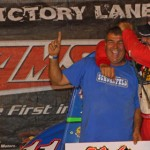 Dave Darland (right) celebrates with his team owner Jeff Walker after winning at Kokomo (Ind.) Speedway Monday evening. (Gordon Gill Photo)
