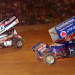 Rod George challenges Jack Sodeman Jr. (23) during sprint car feature competition at Pennsylvania's Lernerville Speedway. (Hein Brothers photo)