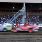 Modifieds flash past the main grandstand during the Lou Blaney Memorial at Ohio's Sharon Speedway. (Joe Secka/JMS Pro photo)