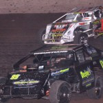 Jeremy Christians (99) and Craig Priewe (1) battled for the lead during the modified feature at Beaver Dam Raceway in Wisconsin. (Bob Cruse photo)