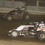 Robert Ballou (81) and Jon Stanbrough fight for the lead during USAC sprint car competition at Valley Speedway in Grain Valley, Mo. (Mark Funderburk photo)