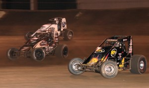 Bryan Clauson (7) makes his way by Tracy Hines (4) and Hunter Schuerenberg en route to victory on a preliminary night during last year's Sprint Car Smackdown at Kokomo (Ind.) Speedway. (Gary Gasper Photo)