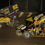 Mike Reinke (02) battles Phillip Mock during IRA sprint car action at Lasalle (Ill.) Speedway. (Mark Funderburk photo).