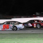 Eddie Hoffman (8) races John Nutley (96) early in the late model feature at Indiana's Illiana Speedway Saturday night. Hoffman went on to win the race and take over the point lead. (Gary Gasper photo)