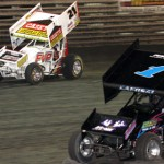 Danny Lasoski (1z) charges under his nephew, Brian Brown, Sunday night at Iowa's Knoxville Raceway. (Dick Ayers photo)
