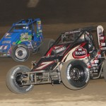 Dave Darland (11) chases eventual winner Bryan Clauson during sprint car feature action at Indiana's Kokomo Speedway in August. Both men are in the hunt for the USAC National sprint-car crown. (Gordon Gill Photo)