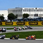 The MotoGP field flows through a turn during Sunday's Red Bull Indianapolis GP Sunday at Indianapolis Motor Speedway. (Michael Roth/IMS Photo)