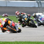 Dani Pedrosa (26) leads Jorge Lorenzo (99) and Andrea Divizioso during MotoGP action at Indianapolis Motor Speedway in 2012. (Ginny Heithaus Photo)