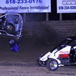 Chett Gehrke in the middle of a violent flip as Brett Anderson passes by during the POWRi Midget Series race at Belle-Clair Speedway in Illinois. (Don Figler photo)