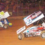 Battling for positions during the sprint car main at Lernerville Speedway are Jack Sodeman Jr. (23) and Dan Kuriger (08). (Hein Brothers photo)