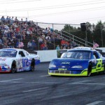 J.P. Morgan (23) and Tyler Young (02) lead the CARS Pro Cup Series field during a parade lap at Ace Speedway in Altamahaw, N.C., earlier this season. (Adam Fenwick/AKFPhotos.com Photo)