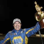 Ron Capps celebrates after winning the NHRA Funny Car final at zMAX Dragway in Concord, N.C., on Sept. 16. (HHP/Harold Hinson Photo)