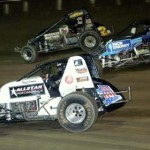 Steve Irwin (1), Todd Kane (78) and Dallas Hewitt go three-wide during the USAC AMSOIL National Sprint Car Series feature at Eldora Speedway Saturday. (Hein Brothers Photo)