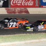 Eventual winner Dan Fredrickson (36) inches under Jacob Goede during ASA Midwest Tour action at Minnesota's Elko Speedway. (Doug Hornickel photo)