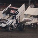 Jason Johnson (41) races away from Travis Rilat en route to winning the Lucas Oil ASCS Sprint Car Series race at The Dirt Track at Texas Motor Speedway. (Owen & Lynne Richards photo)