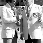 Chris Economaki talks with Al Michaels. (NSSN Archives Photo)