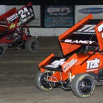 Bryan Sebetto (24) races around Dale Blaney at Ohio's Fremont Speedway. (Action photo)