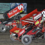 Bryan Sebetto (24) charges under Craig Mintz en route to claiming the FAST sprint car championship at Fremont (Ohio) Speedway. (Action photo)