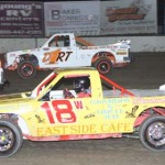 Cory Ward (18) fights off Dustin Keegan (18) during dirt truck competition at Ohio's Fremont Speedway. (Action photo)