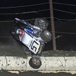 Daniel Robinson tested the outside wall of Jacksonville (Ill.) Speedway at the Lucas Oil POWRi National Midget Series Herb Barlow Memorial.  Robinson was uninjured. (R.J. Brown Photo)