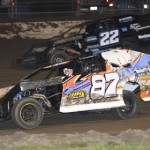 Modified competitors slug it out at Lakeside Speedway in Kansas City, Kan. (Ivan Veldhuizen photo)