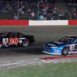 James Swan (97) and Frank Slabenak Jr. battle for the lead during the 50-lap Mid-American Stock Car Series feature at Wisconsin's Jefferson Speedway. (Mark Melchiori photo)