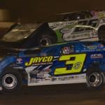 Jason Feger (25) battles Brian Shirley at Peoria (Ill.) Speedway. (Rocky Ragusa photo)