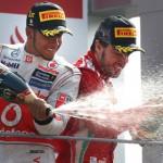 Lewis Hamilton (left) and Fernando Alonso celebrates their podium finishes during Sunday's Italian Grand Prix. (Steve Etherington Photo)