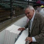 Chris Economaki inspects the SAFER Barrier at Indianapolis Motor Speedway. (NSSN Archives Photo)