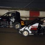 Danny Stratton battles Brett Anderson during POWRi National Midget Series competition at Jacksonville (Ill.) Speedway. (Mark Funderburk Photo)