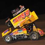 Jac Haudenschild (59) and Sammy Swindell battle for position at Pennsylvania's Lernerville Speedway. (Julia Johnson photo)
