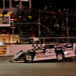 Darrell Lanigan takes the checkered flag to win the Down & Dirty 100 at Michigan's Berlin Raceway. (Randy Ellen photo)