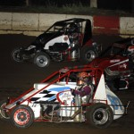 Brad Kuhn, Tyler Thomas and Rich Camfield battle during the Lucas Oil POWRi National Midget Series event at Jacksonville (Ill.) Speedway earlier this year. (Mark Funderburk Photo)