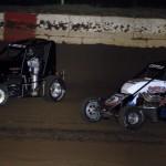Danny Stratton battles Colten Cottle at Jacksonville (Ill.) Speedway Friday night. (Mark Funderburk Photo)