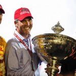 Ryan Hunter-Reay (left) stands with IZOD IndyCar Series CEO Randy Bernard and team owner Michael Andretti after winning the IZOD IndyCar Series title. (Photo Courtesy IZOD IndyCar Series)