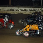 Jeff Fesher, Cameron Hagin, Eric Johnson and Tyler Thomas all try and occupy the same space during Friday's Lucas Oil POWRi National Midget Series race at Jacksonville (Ill.) Speedway. (Mark Funderburk Photo)