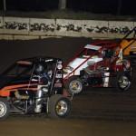 John Campbell, Zach Daum and Eric Johnson go three-wide at Jacksonville (Ill.) Speedway Friday night. (Mark Funderburk Photo)