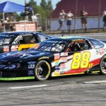 Nick Sweet (88) battles Austin Theriault during the 2011 running of the Oxford 250 at Oxford Plains Speedway in Maine. (Eric LeFleche Photo)