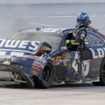Jimmie Johnson climbs from his damaged No. 48 Chevrolet after 'The Big One' destroyed his car Sunday at Talladega (Ala.) Superspeedway. (HHP/Alan Marler Photo)