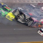 Tony Stewart flips into a pile of other cars during 'The Big One' at Talladega (Ala.) Superspeedway. The crash took place on the final lap of Sunday's Good Sam Roadside Assistance 500. (HHP/Brian Lawdermilk Photo)
