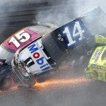 Tony Stewart (14) and Clint Bowyer (15) go for a wild ride during 'The Big One' Sunday at Talladega (Ala.) Superspeedway. (HHP/Brian Lawdermilk Photo)