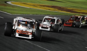 Modifieds race through a corner during the UNOH Southern Slam 150 at Charlotte Motor Speedway in 2012. (HHP/Brian Lawdermilk Photo)