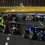 Gary Putnam (77) leads Tim Brown and several other cars through into a turn during the UNOH Southern Slam 150 at Charlotte Motor Speedway last October. (NASCAR Photo)